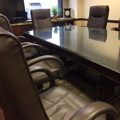 The boardroom at Herman Law with comfortable chairs